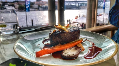 The steak at Q Dining with Sydney Harbour view in the background