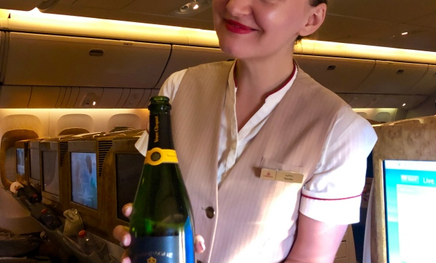 Our flight attendant serving Veuve clicquot