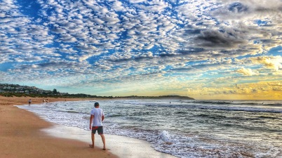 Walking on Dee Why Beach at sunrise